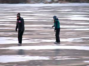 skating on frozen lake