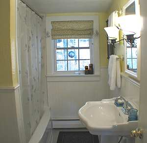 Bathroom with tub shower and sink
